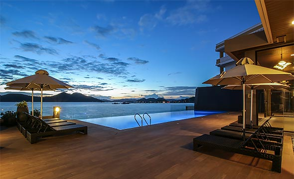 A refreshing dip in the infinity pool comes with a panoramic view of the bay