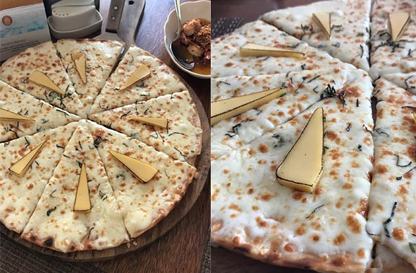 The Four Cheese Pizza is one of the most famous dishes by Two Seasons