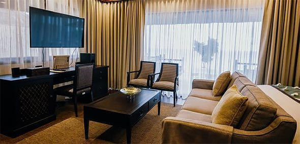 Luxe amenities include a flat-screen TV and quality furnishings