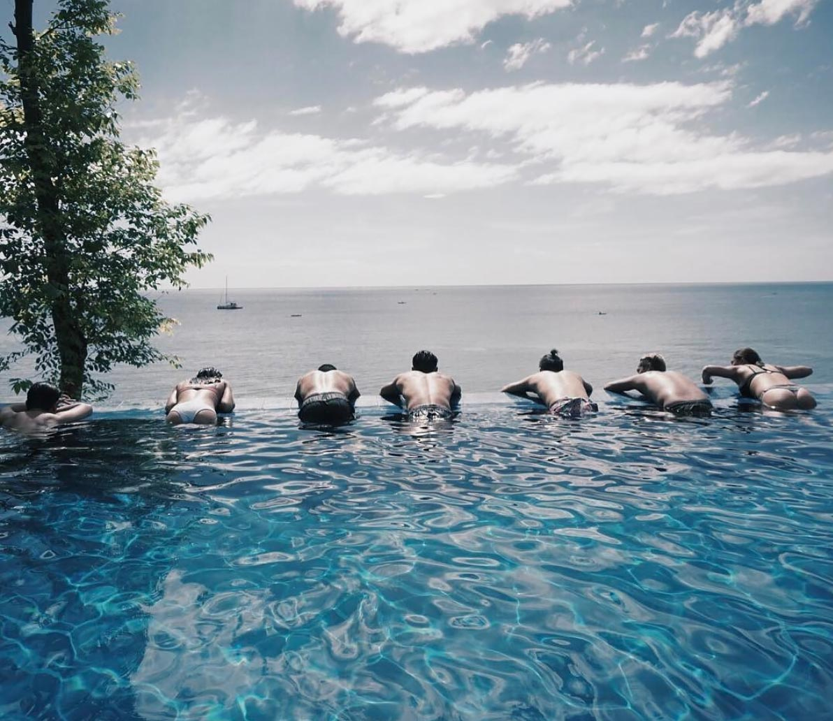 With their friends at the infinity pool